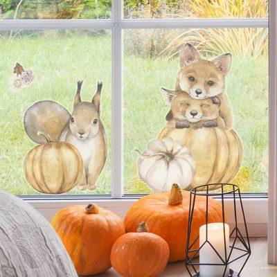 pumpkin and woodland animal window sticker packs (option 2), autumn window stickers. Squirrel with pumpkin, two foxes resting on top of each other with bottom fox head on pumpkin.