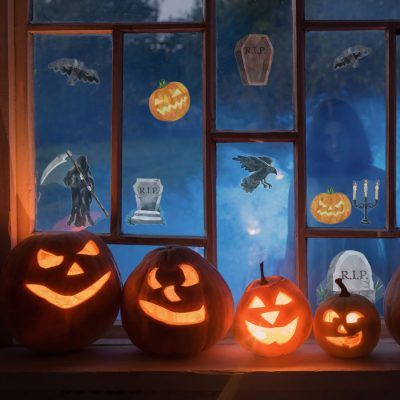 scary halloween window stickers, halloween window stickers, image shows stickers pasted on a window with four pumpkins in front and a spooky ghost outside