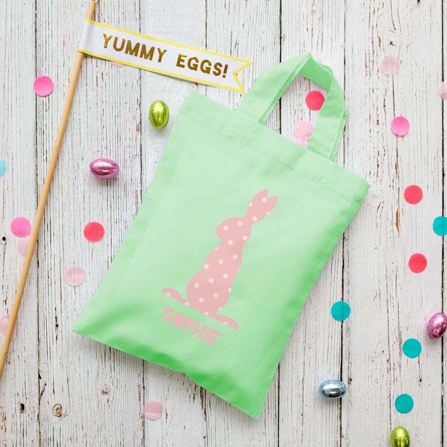 This personalised pink bunny Easter bag in mint green is the perfect way to make your child's Easter egg hunt super special this year