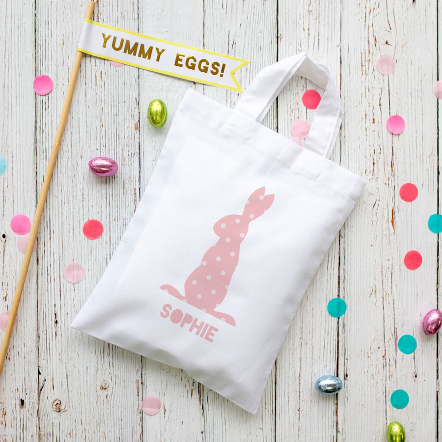 This personalised pink bunny Easter bag in white is the perfect way to make your child's Easter egg hunt super special this year
