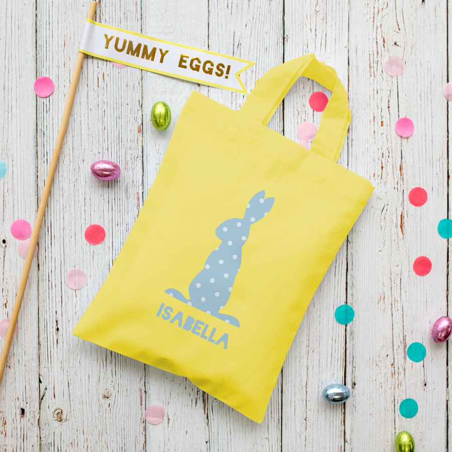 This personalised blue bunny Easter bag in yellow is the perfect way to make your child's Easter egg hunt super special this year