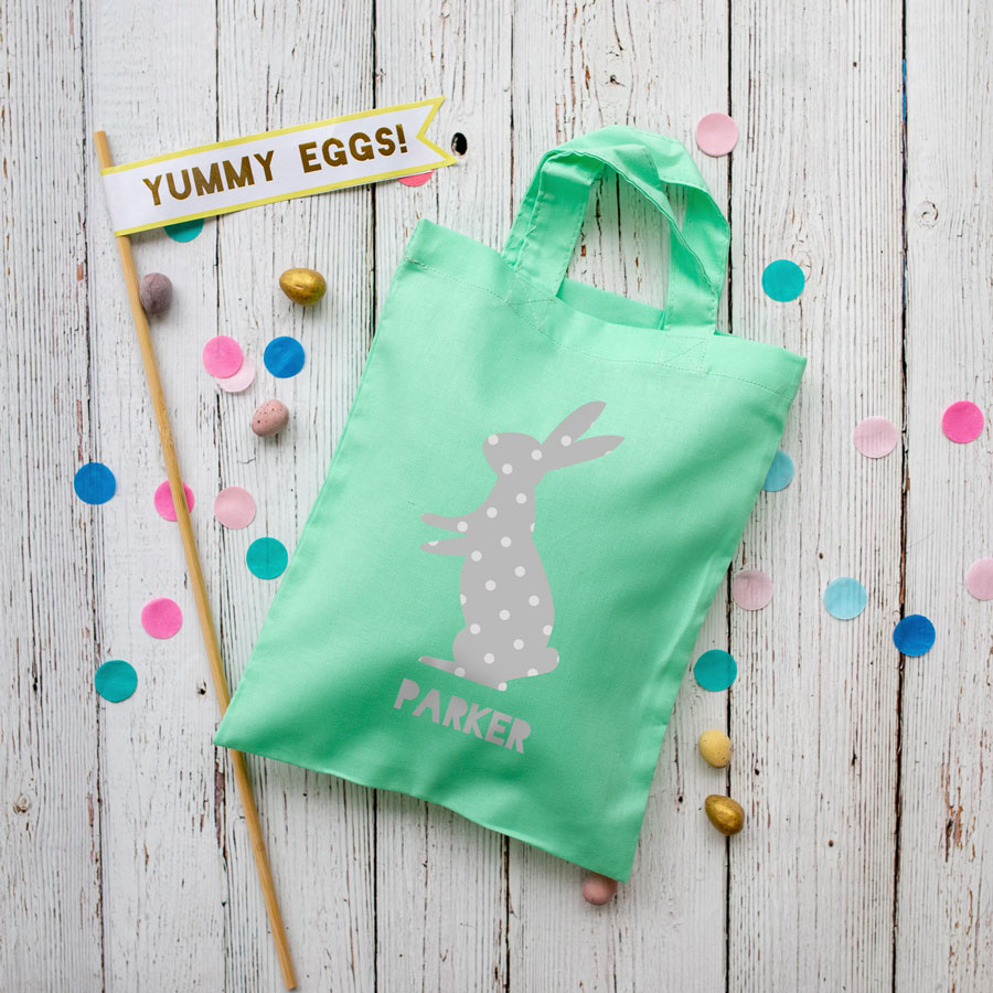 This personalised grey bunny Easter bag in mint green is the perfect way to make your child's Easter egg hunt super special this year