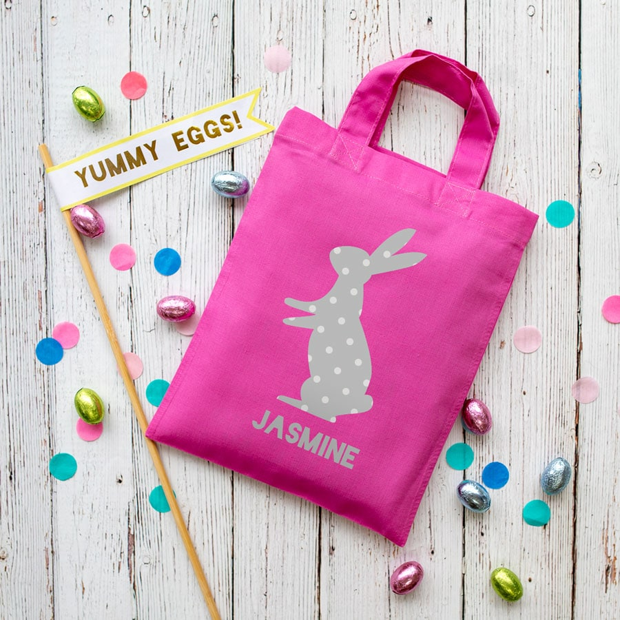 This personalised grey bunny Easter bag in pink is the perfect way to make your child's Easter egg hunt super special this year