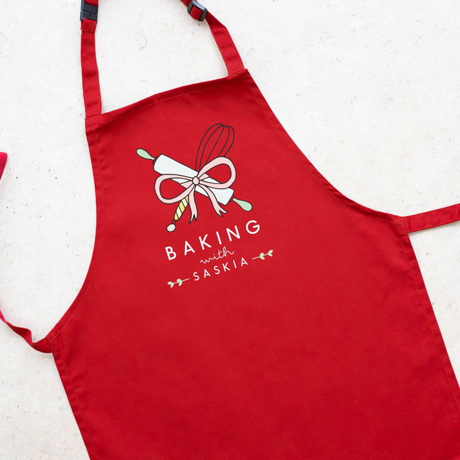 Personalised baking apron (Adult - Red) is a perfect gift for a keen baker and fully personalisable with a name of your choice