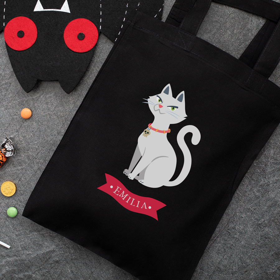 Personalised cat trick or treat bag (Black) perfect for Halloween trick or treat featuring a cat and personalised banner