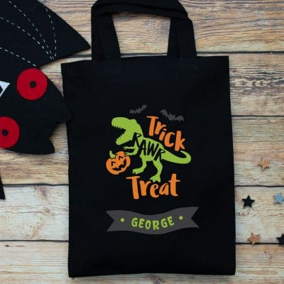 Personalised dinosaur trick or treat bag (Black) perfect for Halloween trick or treat featuring a dinosaur and personalised banner