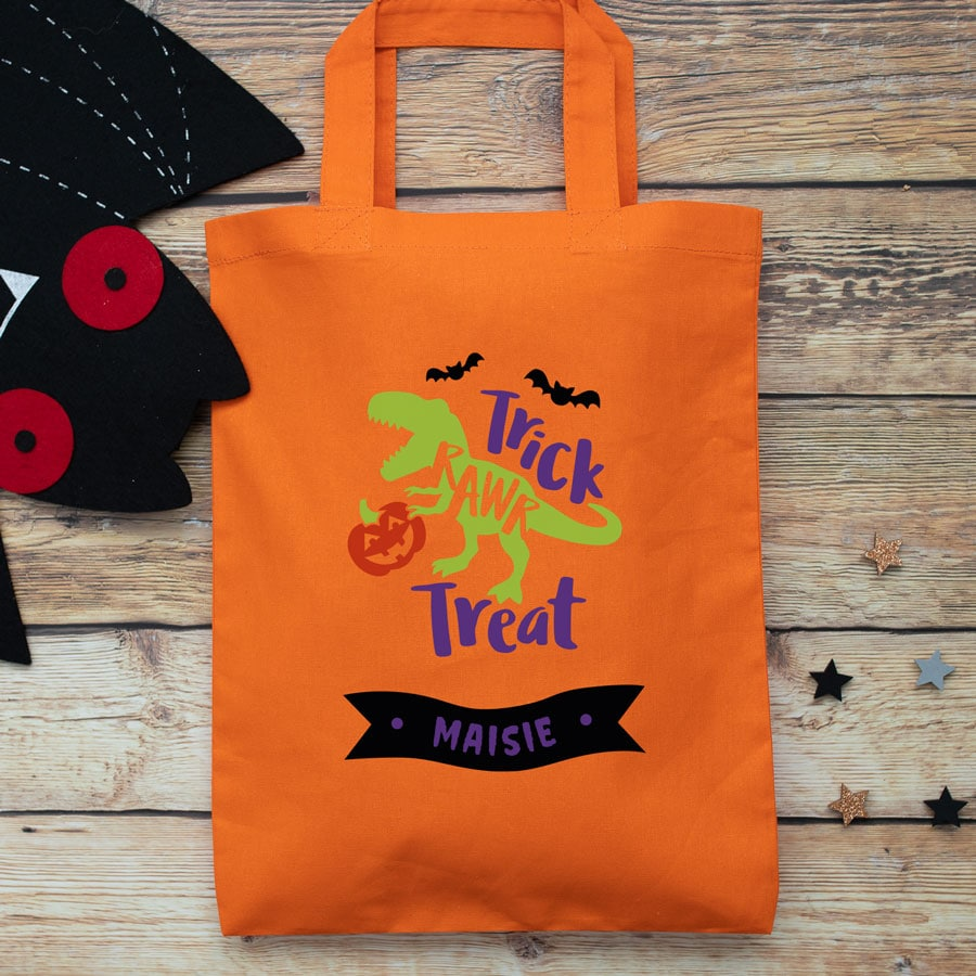 Personalised dinosaur trick or treat bag (Orange) perfect for Halloween trick or treat featuring a dinosaur and personalised banner