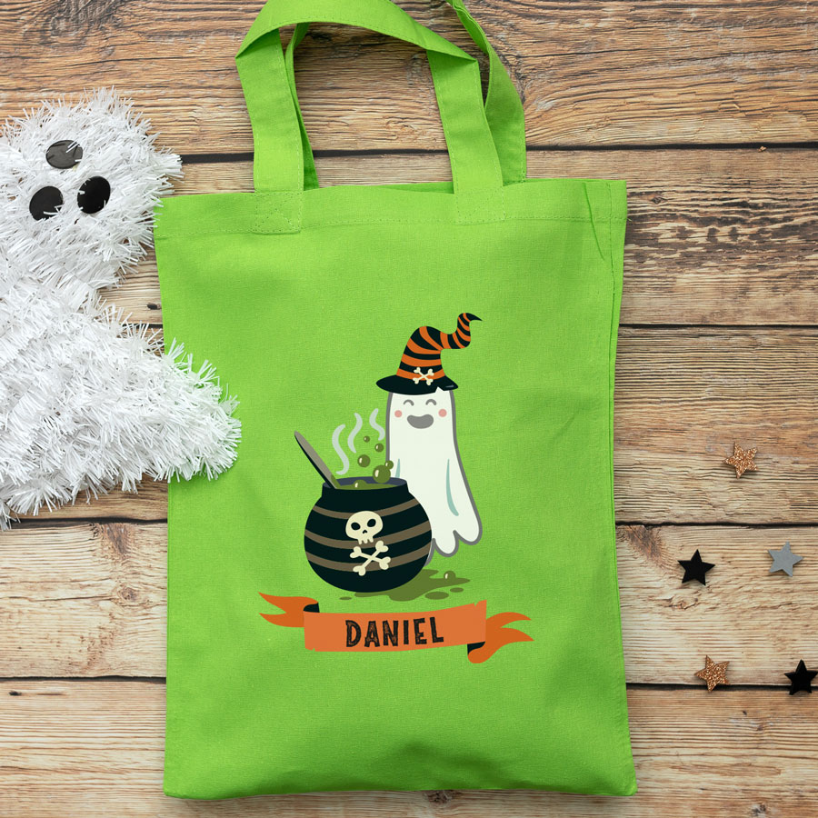Personalised ghost and cauldron trick or treat bag (Green) perfect for Halloween trick or treat featuring a ghost and cauldron and personalised banner
