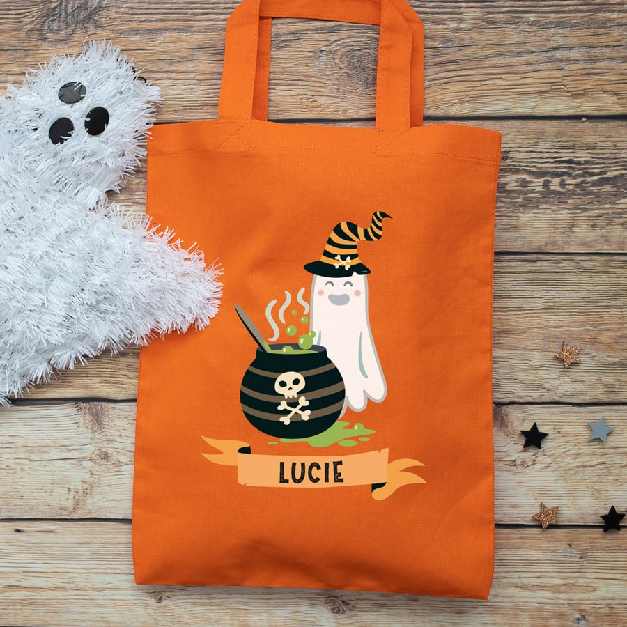 Personalised ghost and cauldron trick or treat bag (Orange) perfect for Halloween trick or treat featuring a ghost and cauldron and personalised banner