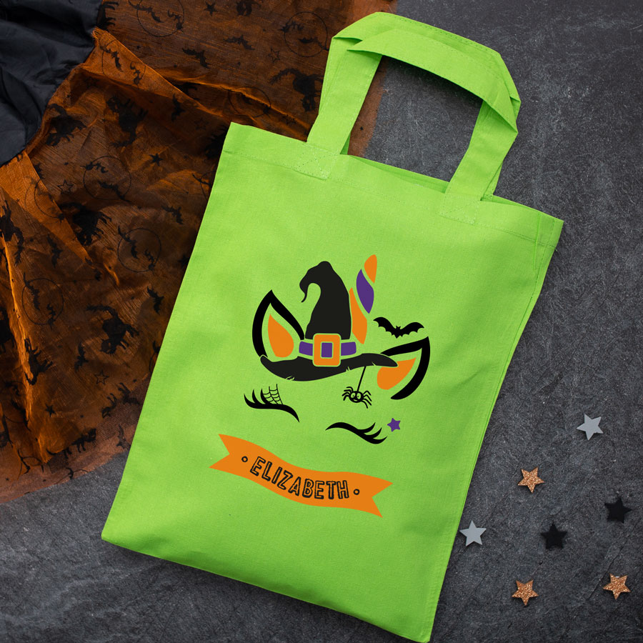 Personalised unicorn witch trick or treat bag (Green) perfect for Halloween trick or treat featuring a unicorn witch and personalised banner
