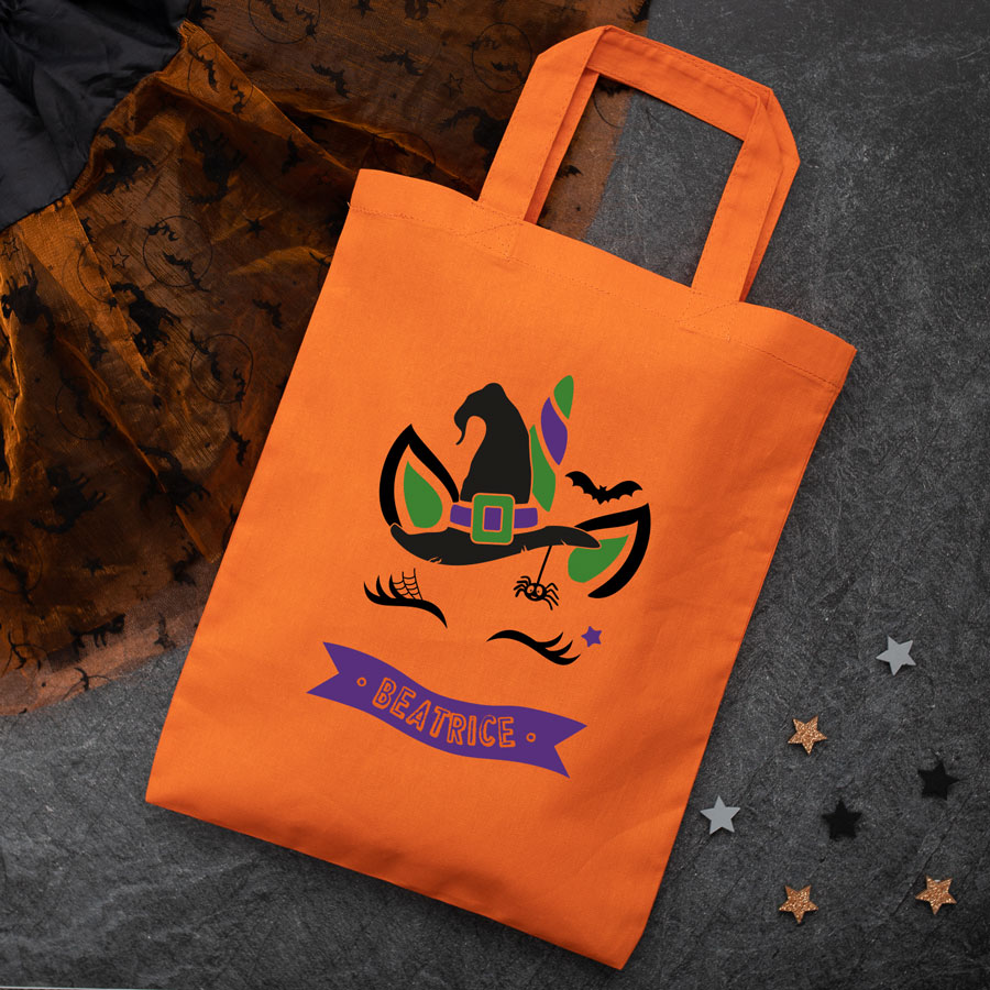 Personalised unicorn witch trick or treat bag (Orange) perfect for Halloween trick or treat featuring a unicorn witch and personalised banner
