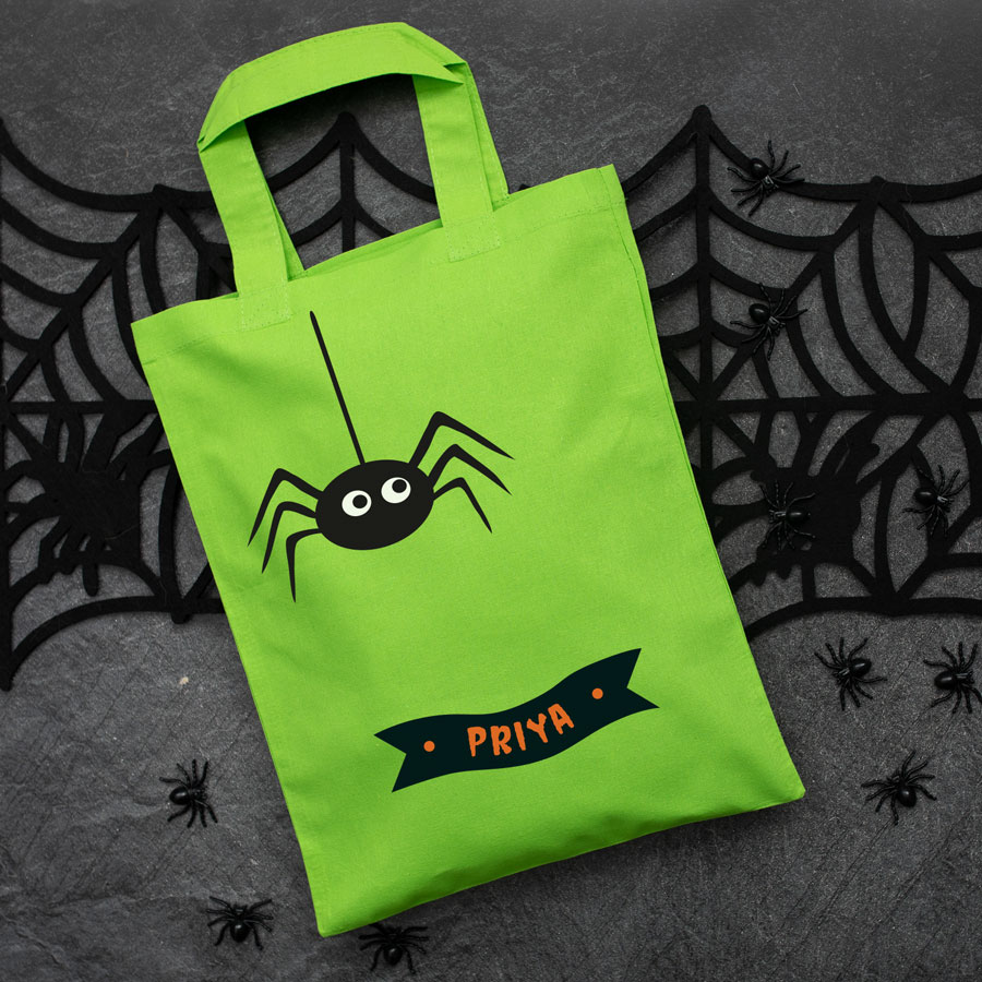 Personalised spider trick or treat bag (Green) perfect for Halloween trick or treat featuring a spider and personalised banner