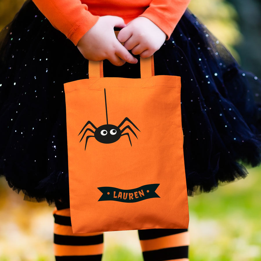 Personalised spider trick or treat bag (Orange) perfect for Halloween trick or treat featuring a spider and personalised banner