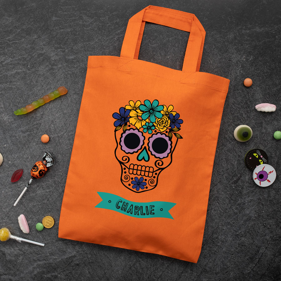 Personalised skull trick or treat bag (Orange) perfect for Halloween trick or treat featuring a skull or calavera and personalised banner