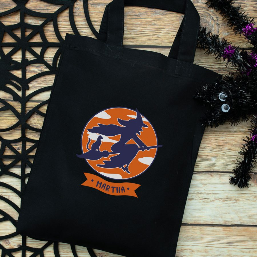 Personalised witch and cat trick or treat bag (Black) perfect for Halloween trick or treat featuring a witch and cat on a broomstick and personalised banner