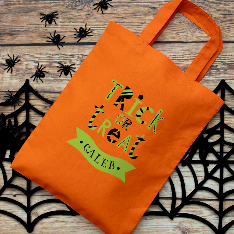 Personalised trick or treat bag (Orange) perfect for Halloween trick or treat featuring trick or treat quote and personalised banner