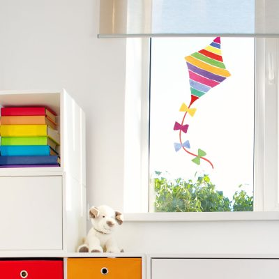 Rainbow kite window sticker perfect for a child's bedroom window to brighten up their room with vibrant rainbow colours