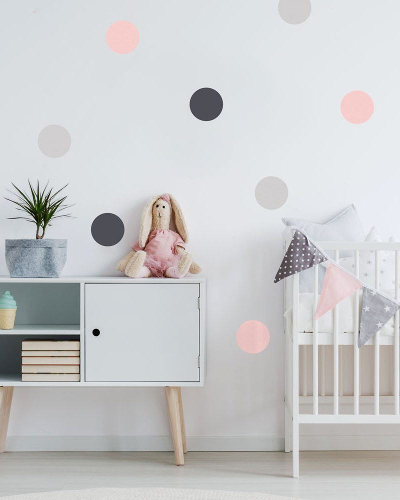Grey and pink spot wall stickers perfect for creating a contemporary theme for a baby's nursery