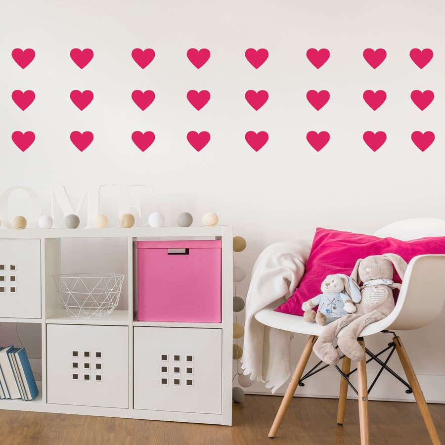 Hot pink heart wall stickers from our peel and stick collection quick and easy to apply to decorate your childs room.