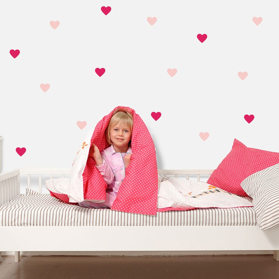 Light pink and hot pink heart wall stickers from our peel and stick collection quick and easy to apply to decorate your childs room.