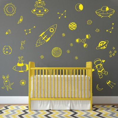 contemporary space wall decals in yellow with rockets, satellites and planets