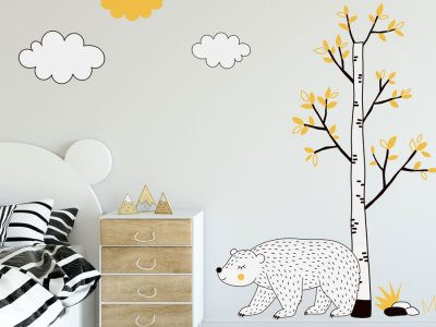 Woodland animal wall sticker scene featuring a tree, bear and clouds all with black, yellow and white accents