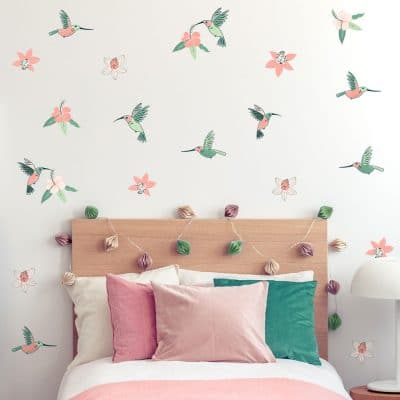 Hummingbird and Hibiscus jungle wall sticker pack. Image shows teal, green and pink hummingbirds and hibiscus flowers on wall around a single bedframe with pink and white bedding.