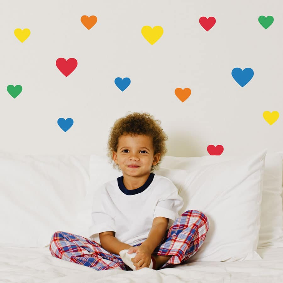 Bright rainbow heart wall stickers from our peel and stick collection quick and easy to apply to decorate your childs room