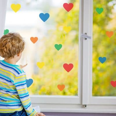 Bright rainbow heart window stickers quick and easy to apply to decorate your childs room.