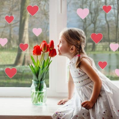 Pink and red heart window stickers with girl smelling flowers perfect for decorating for Valentines Day