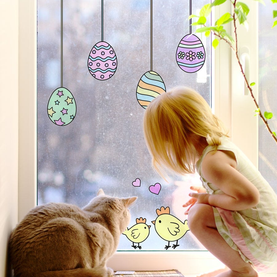 Easter colour in window sticker pack featuring Easter themed window stickers on a window with girl and cat