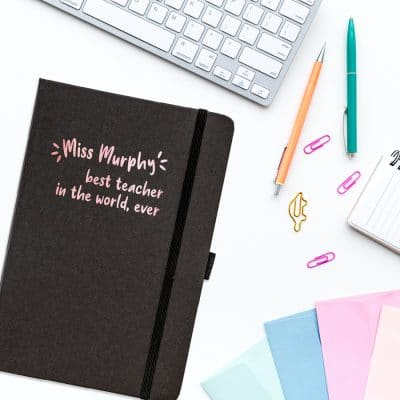 Personalised best teacher in the world notebook in black features the text 'best teacher in the world, ever' plus personalised name underneath and is a perfect gift for a teacher or teaching assistant to say thank you