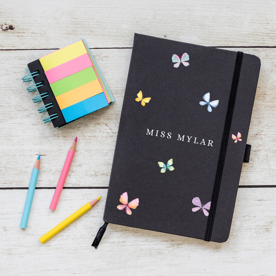 Personalised butterflies notebook in black features six butterflies in pastel shades with the name of your choice in the centre of the notebook and is a perfect gift for a teacher or teaching assistant to say thank you