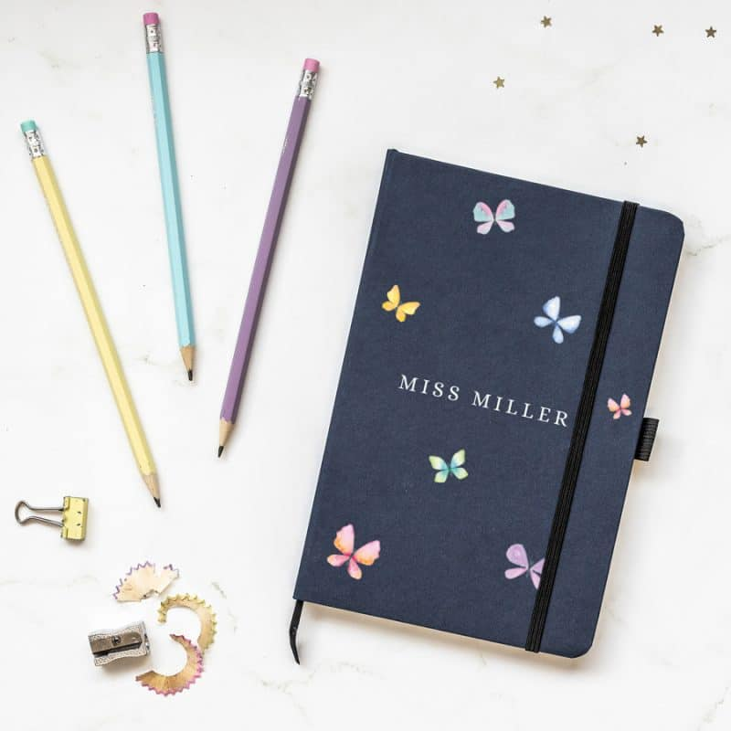 Personalised butterflies notebook in blue features six butterflies in pastel shades with the name of your choice in the centre of the notebook and is a perfect gift for a teacher or teaching assistant to say thank you