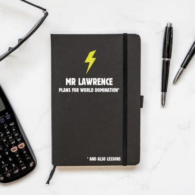 Personalised world domination notebook in black features a yellow lightning bolt with a name of your choice and text 'plans for world domination' all in whiteand is a perfect gift for a teacher or teaching assistant to say thank you