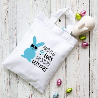 Hand over the eggs Easter bag (White) perfect for your child's Easter egg hunt this year