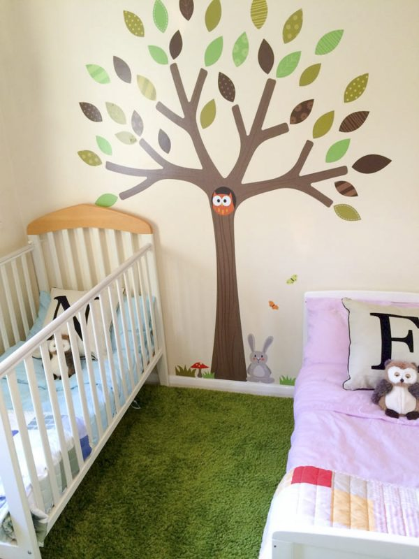 A nursery for a boy and girl transformed with this unisex woodland theme
